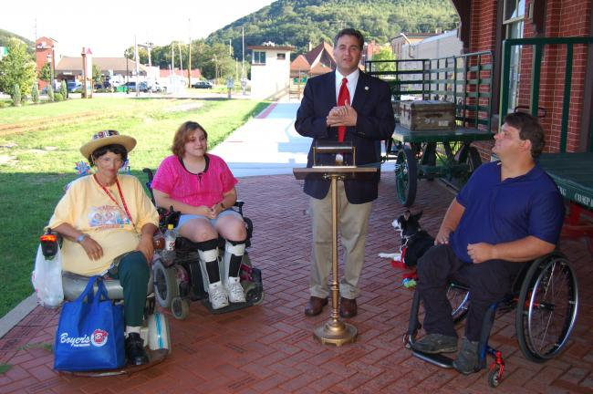 JOE PLASKO/TIMES NEWS Tamaqua Mayor Christian Morrison, second from right, reads a proclamation reaffirming the borough's commitment to full compliance with the Americans with Disabilities Act (ADA) on the 20th anniversary of the enactment of ADA…