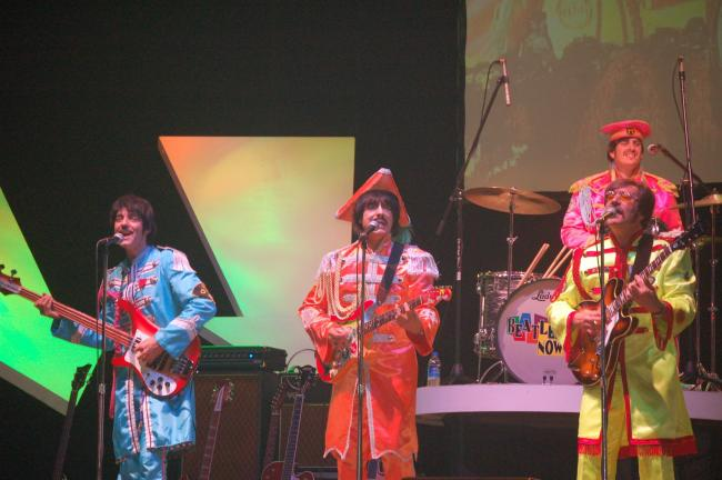 Sgt. Pepper's Lonely Hearts Club Band made an appearance during the performance of Beatlemania Now at Penn's Peak Saturday night. JOE PLASKO/TIMES NEWS