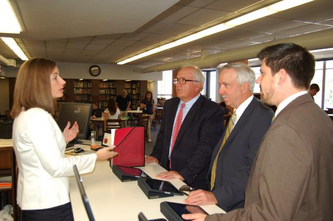 JOE PLASKO/TIMES NEWS Melissa Day, left, Tamaqua Area High School library media specialist, explains the advantages of the iPad. Listening are Tamaqua Blue Raider Foundation Vice President Walter Kruczek and treasurer Jeffrey Bowe and Ken…
