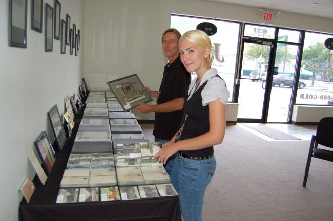 TERRY AHNER/TIMES NEWS Jen Graver and her father, Joseph Schock, owner of the newly opened J & J Coins at 631 Delaware Avenue in Palmerton, proudly display their impressive collection inside their shop.