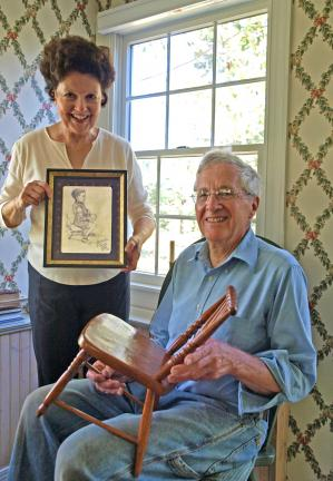 """AL ZAGOFSKY/SPECIAL TO THE TIMES NEWS Jacky Bisbing holds a sketch of her husband, Henry, that is signed, """"Best Wishes/Franz Josef Kline/38."""" Henry holds the chair he was sitting in when the sketch was made."""