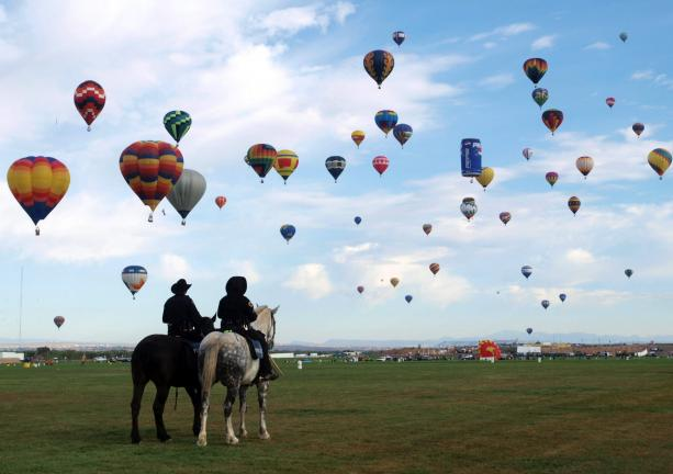 Albuquerque Mounted Police Officers Watch As 500 Rainbow Colored And Designer Shaped Air