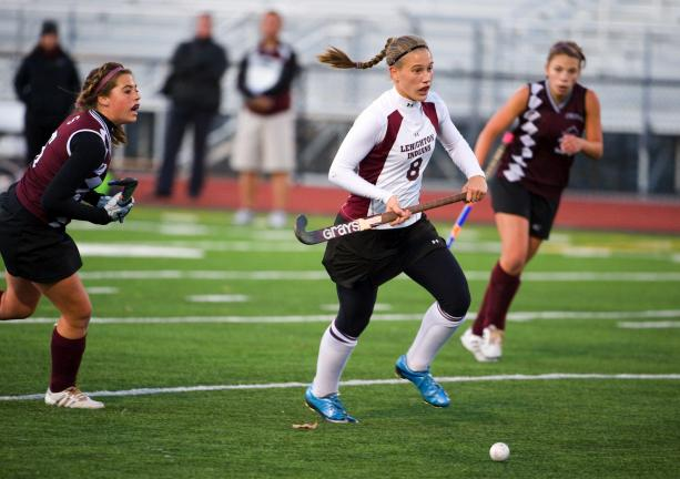 bob ford/times news Lehighton's Jordyn Homyak (8) heads up field with the ball as Stroudsburg's Taylor Secor (left) chases from behind.