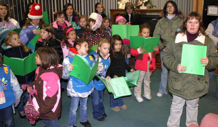 Andy Leibenguth/special to the times news Members of Tamaqua Girls Scouts Service Unit 310 entertain with holiday carols.