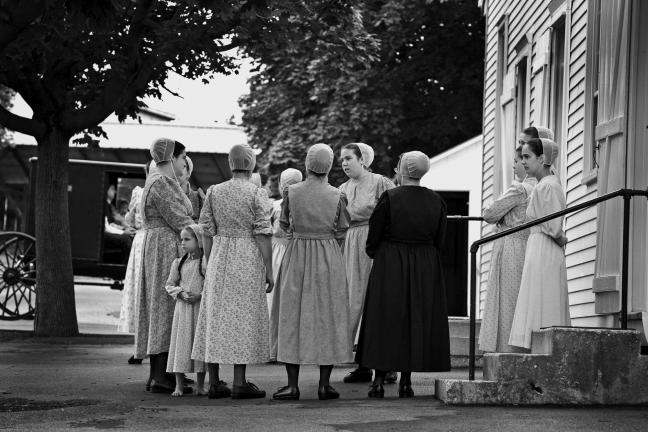 Brad Browne/special to The TIMES NEWS A group of Old Order Mennonite women meet in front of a church before the service begins. Until the early 20th century, German was the language spoken in Lancaster County, Pa.