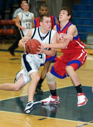 bob ford/times news Tamaqua's Mike Streisel (left) drives to the basket as Jim Thorpe's TJ Prontnicki defends.