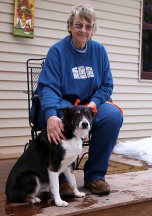AL ZAGOFSKY/SPECIAL TO THE TIMES NEWS Susan Bulanda, a Certified Animal Behavior Consultant, sits with her retired search and rescue dog, Gus. She writes and teaches about how animals behave in their natural conditions.