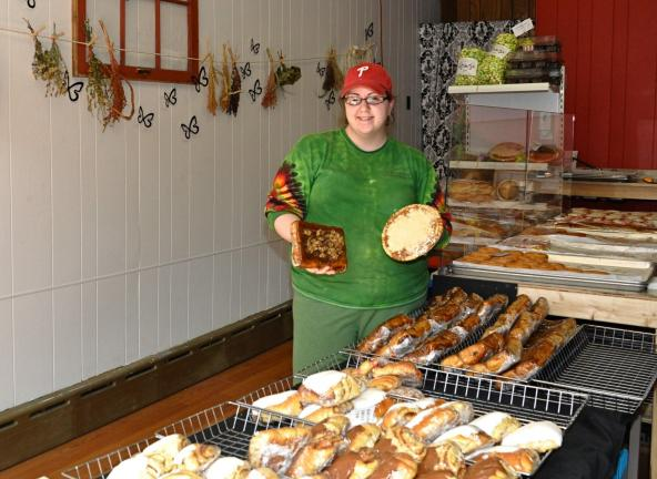 VICTOR IZZO/SPECIAL TO THE TIMES NEWS Tasty Maid Bakery co-owner Roxann Strohl holds up two of the bakery's most popular items, sticky buns and a shoo-fly pie at their newest location at 38 Broadway in downtown Jim Thorpe.