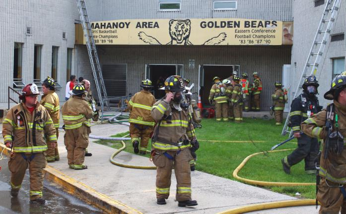 ANDREW LEIBENGUTH/SPECIAL TO THE TIMES NEWS Heavy damage occurred Memorial Day when a fire ravaged a building at the Mahanoy City Area school complex, forcing the closing of school today and perhaps for the rest of the school year.