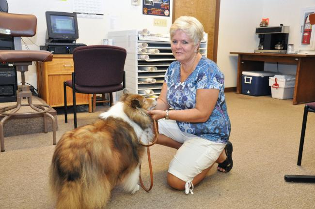 AMY MILLER/TIMES NEWS Rose Reese, a certified dog trainer who is working to become a certified TTouch practitioner, gets ready to illustrate what she is learning about the Linda Tellington-Jones' TTouch system during Tuesday's Carbon County Animal…
