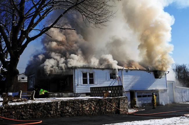 LARRY NEFF/SPECIAL TO THE TIMES NEWS Rising smoke from a structure fire in West Penn yesterday could be seen for miles as firefighters responded to the scene.