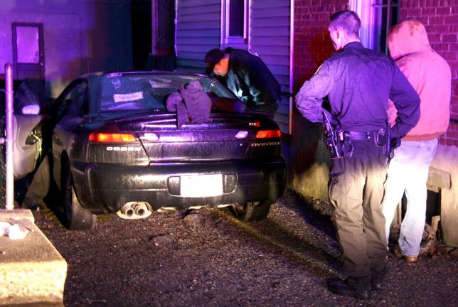 ANDREW LEIBENGUTH/TIMES NEWS Tamaqua and Rush Township police cruisers could be seen converged Saturday evening between two Pine Street homes in Tamaqua, where police searched a vehicle involved in a retail theft at WalMart.