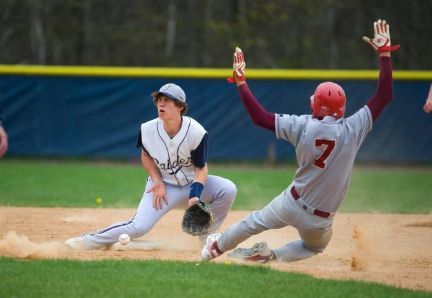 bob ford/times news Tamaqua's Ian Nicholls goes down to block a throw at second base as Pine Grove's Nick Todero (7) slides in safely.