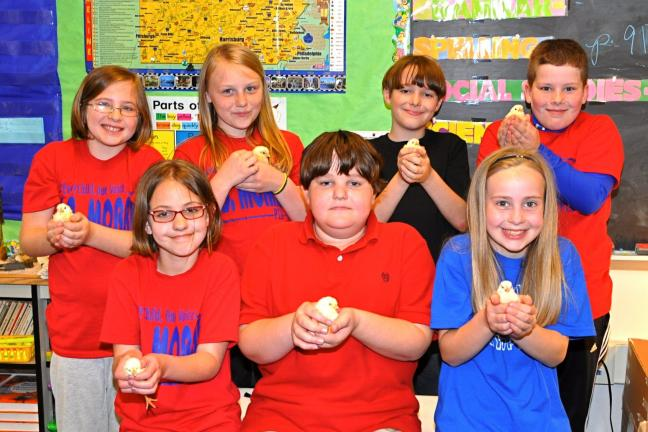 """VICTOR IZZO/SPECIAL TO THE TIMES NEWS Gently holding some of the chicks hatched out during their fourth grade's 4-H project called """"Embryology"""" are L.B. Morris Elementary School students, front, left to right : Teegan Kunkle, Tanner Horn, and…"""