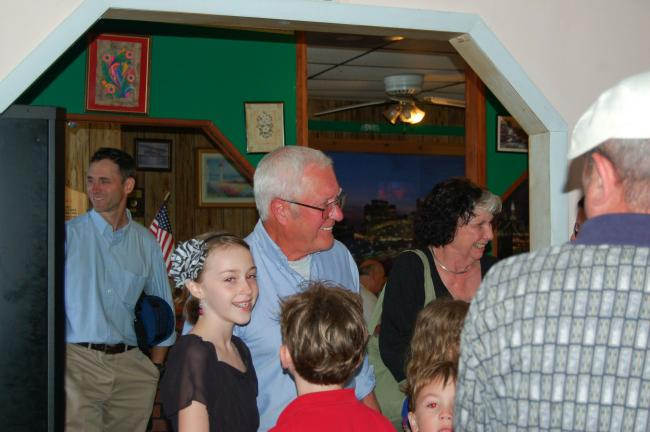 Dr. Thomas Pollock arrives at Cabrera's Pizzeria and Restaurant, Lansford, with his family.
