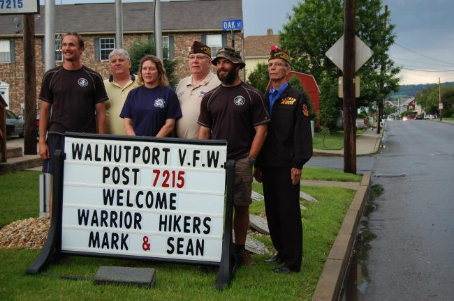 ELSA KERSCHNER/TIMES NEWS Mark Silvers, Commander Bruce Jones, Auxiliary and District 20 President Karen Bandzi, Sean Gobin and District Commander Steve Cales with the sign that pleased the two visiting men.