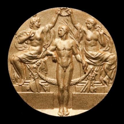 (Photo by Katherine Fogden, NMAI) This is a duplicate of Jim Thorpe's Gold Medal which he won in the Decathlon at 1912 Olympic Games in Stockholm and was presented to his family in 1983. The original medal was lost or stolen. Courtesy of Smithsonian…