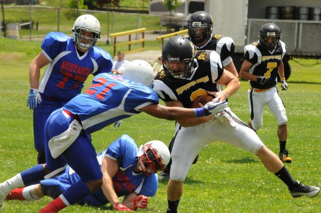 RON GOWER/TIMES NEWS Summit Hill Breaker Boys quarterback Craig Zurn finds himself in trouble on a running play as members of the Elizabethtown Mustangs close in on him. The Mustangs defeated the Breaker Boys, 73-52.