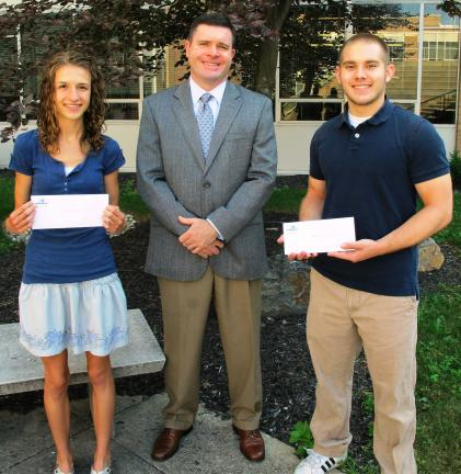 ANDREW LEIBENGUTH/TIMES NEWS From left are recipient Kelsey Patrick, 17; Eric Zizelmann, TBRF treasurer; and recipient Anthony Iacoviello, 18.