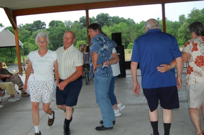 Carl and Louise Mengel promenade during the square dance held at the park pavilion.