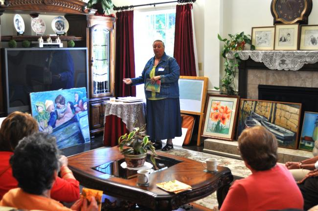 Artist Donna Bieren speaks to a group of 40 women during a recent presentation in Barnesville.