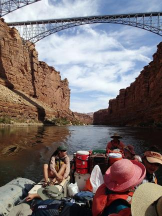 AL ZAGOFSKY/SPECIAL TO THE TIMES NEWS Motorized raft passes under Navajo Bridges, four miles below Lee's Ferry. The closer bridge was built in 1929 and is now reserved for pedestrians. The downstream bridge was built in 1995 for vehicles. It is the…