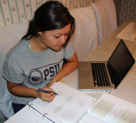 Penn State sophomore Andrea Rodgers, 19, of Coaldale, spends time studying for a business statistics exam. Rodgers is majoring in business management. She is also a captain of the Hazleton Campus cheerleaders.