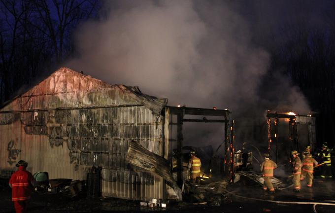 ANDREW LEIBENGUTH/TIMES NEWS A large storage garage in Packer Township was completely gutted during a fast-moving fire yesterday evening.