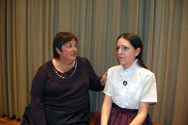 """ABOVE: Marmee (Michelle Stoudt) sings to Jo (Jessica Schafer) during a dress rehearsal for """"Little Women - The Musical.""""  RIGHT: Rehearsing a party scene are cast members, from left, Shirley Rodgers, Jim Cimms, Caitlin Connolly, Marissa Miller and…"""
