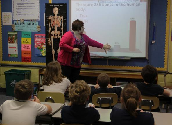 ANDREW LEIBENGUTH/TIMES NEWS Kelly Reaman gives her 4th grade students a quick ungraded test using the new clickers.