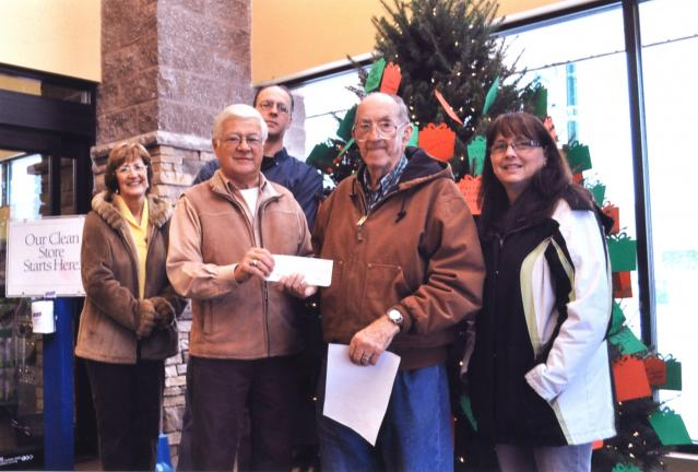 Special to the TIMES NEWS Country Harvest Family Market owner Richard Nothstein (front left) presents a check to Charles Silliman (front center), pantry coordinator for the Christian Action Council of Palmerton Area Churches (CACPAC) for the…