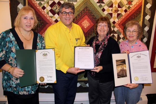 Holding state and local citations and proclamations from left are Nancy Stevens, president, Tamaqua Business and Professional Women's (BPW) Club; Tamaqua Mayor Chris Morrison; Cindy Sabol District 9 director, BPW; and Mary Bridygham, corresponding…