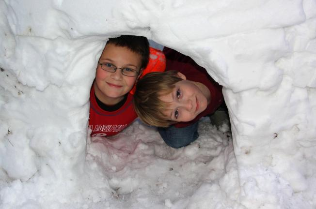 ANDREW LEIBENGUTH/TIMES NEWS Coaldale Cub Scouts Andrew Surotchak, 11, left, and Gavin Brossman, 10, peak their heads out of their snow igloo.