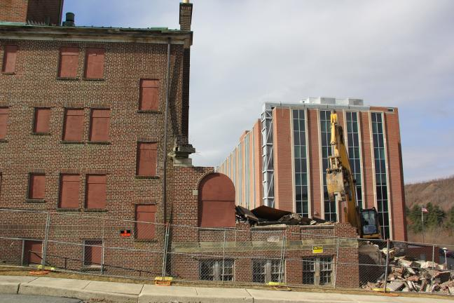 """ANDREW LEIBENGUTH/TIMES NEWS During its long life span, the nurses' residence, which is currently being demolished, also served as a temporary hospital during construction of the """"new"""" hospital. Pictured in the background is the six-story St. Luke's…"""
