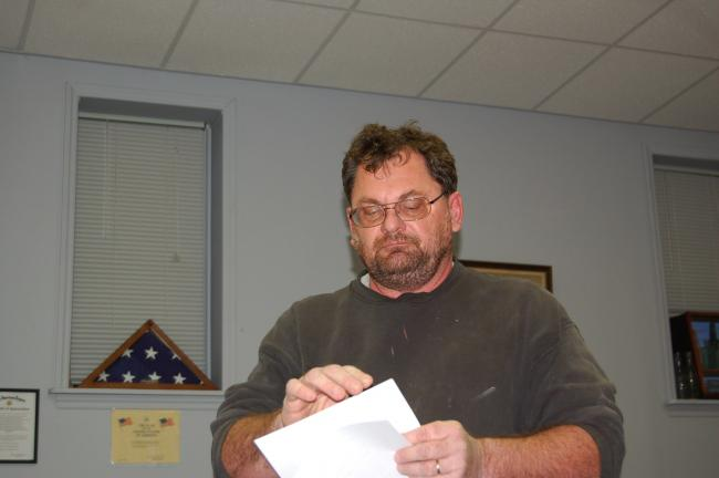 CHRIS PARKER/TIMES NEWS Coaldale resident Francis Hutta distributes documents as part of his contention of wrongdoing by some residents and a borough police officer.