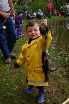 Gail Maholick/TIMES NEWS Levi McCullion, 2, catches his first fish at the Beaver Run Rod and Gun Club fishing event.