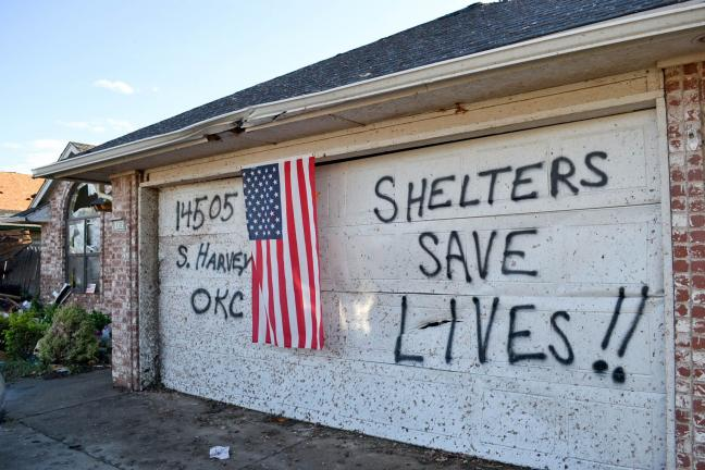 SPECIAL TO THE TIMES NEWS Using their garage as a billboard, the George family sent out a powerful message after surviving the stage EF4 tornado that ripped through Oklahoma City and its suburbs.