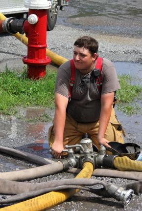 Hometown Fire Company firefighter Dustin Dougherty operates a tanker fill station located outside the Delano Fire Company.