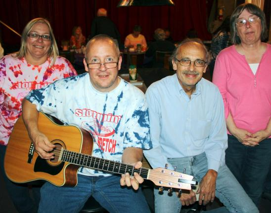ANDREW LEIBENGUTH/TIMES NEWS Pictured during Saturday's event are, l-r, benefit organizer Judi Musselman, Bud Musselman, Jack Kulp and Terry Rex.