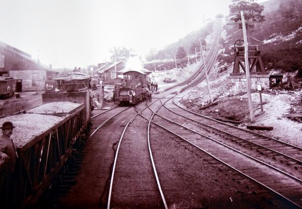 Coal cars, left, wait to be hoisted from the foot of the Mahanoy Plane in this 1890s image.