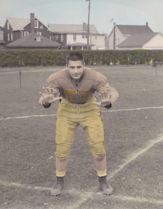 Seventeen-year-old tackle Bruce Frassinelli strikes a pose during Summit Hill High's football season in 1956.