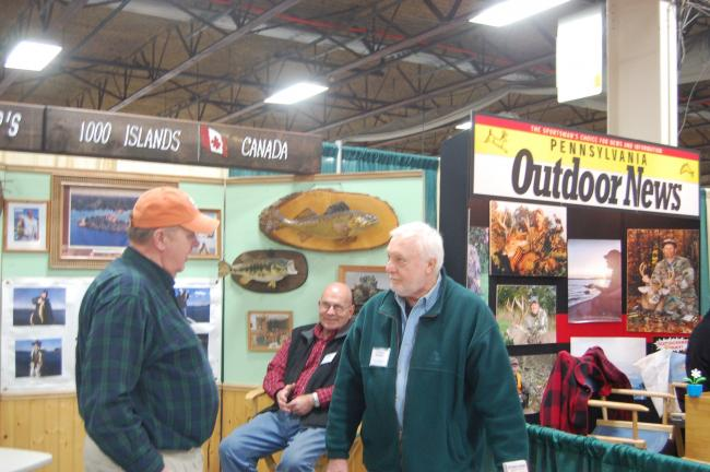 Tom Banditelli, right, of Tamaqua, an owner of Caiger's Resort on the St. Lawrence River in the 1000 Island Region, talks with amateur bass angler Bill Everett of Doylestown to the apparent amusement of Mike Melnick of Tamaqua at last year's Lehigh…