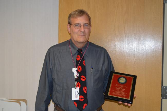 JARRAD HEDES/TIMES NEWS Brian Feick, Lehighton Area School District business manager, won the 2015 National Stem Plus Education Leadership Award for his efforts in securing a Qualified Zone Academy Bond to help start a STEM Plus Academy in the district.