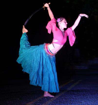 DONALD R. SERFASS/TIMES NEWS  Tamaqua dancer Amanda Carson performs with a saber on South Swatara Street about 8 p.m. during the peak of the Dear Tamaqua extravaganza.