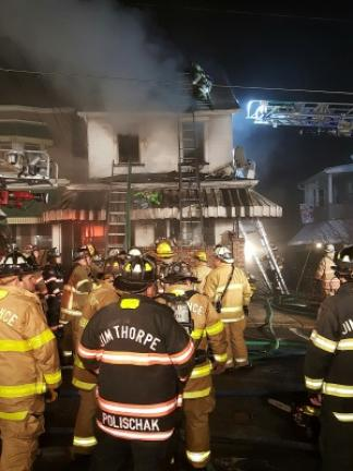 Fire crews on scene at 4 a.m. Sunday at 316 W. Patterson St., in Lansford. COPYRIGHT LARRY NEFF/SPECIAL TO THE TIMES NEWS
