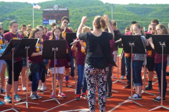 Beth Hudlow directs the Lehighton Middle School Band as it performs the district's alma mater before the STEM Plus Academy of the Year award presentation Tuesday morning.
