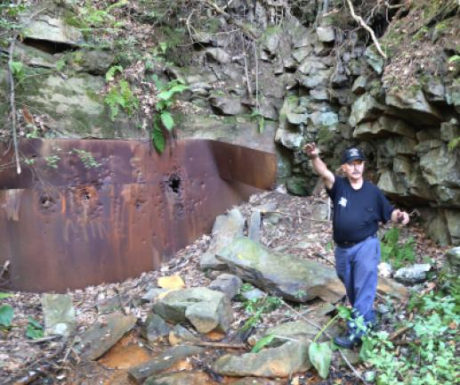 Anthracite mining historian and photographer Michael Havrischak of Coaldale stands at the sealed mine head and explains the dynamics of the 1915 Foster's Mine Tunnel Cave-In, an event that trapped 11 miners for days, all of whom survived. DONALD R…