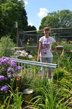 Cheryl Freundt stands in the butterfly garden at her Franklin ...