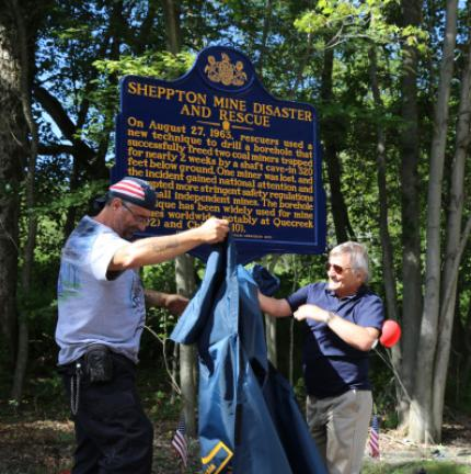 ABOVE: John Bova, left, son of entombed miner Louis Bova, unveils the Sheppton Mine Disaster historical marker on Saturday assisted by J. Ronnie Sando, believed to be the lone surviving rescuer. BELOW LEFT: Louis Bova, right, seen shortly before the…