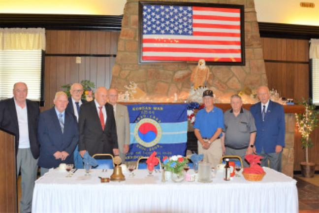 About a dozen members of the Korean War Last Man's Club of